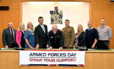 North Wales Fire and Rescue Service sign Flintshire Armed Forces Covenant