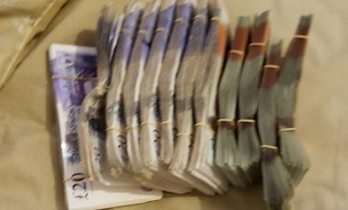 Police raid on Flint house nets over £30,000 in drugs and cash
